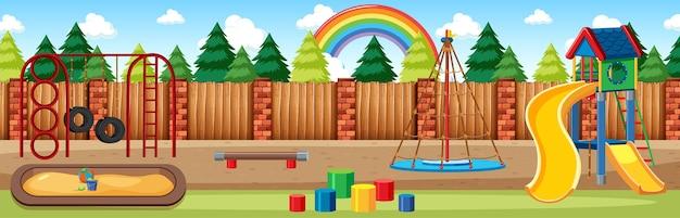 Parque infantil en el parque con arco iris en el cielo en la escena panorámica de estilo de dibujos animados durante el día