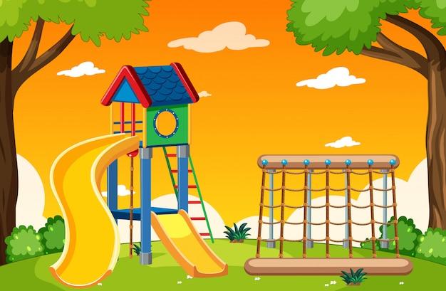 Parque infantil en el parque con estilo de dibujos animados de cielo de luz roja y amarilla