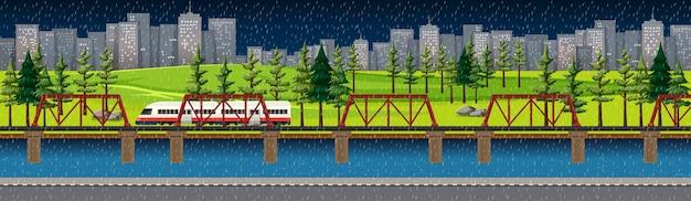 Parque natural de la ciudad con tren en el paisaje del horizonte en la escena nocturna