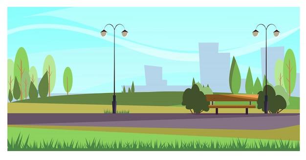 Parque de verano con luces de calle.