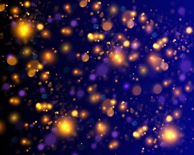 Partículas de polvo amarillo oro mágico espumoso. concepto mágico. fondo negro abstracto con efecto bokeh.