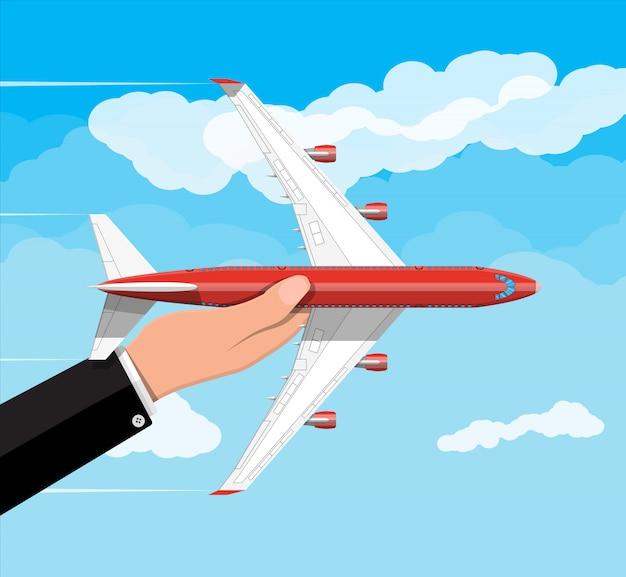 Pasajero o avión comercial en mano