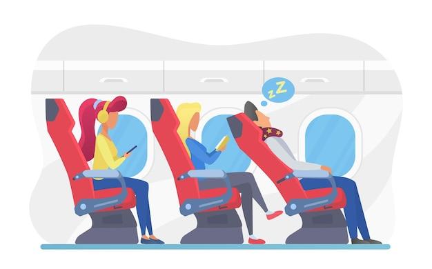 Pasajeros de avión en el interior de la clase económica