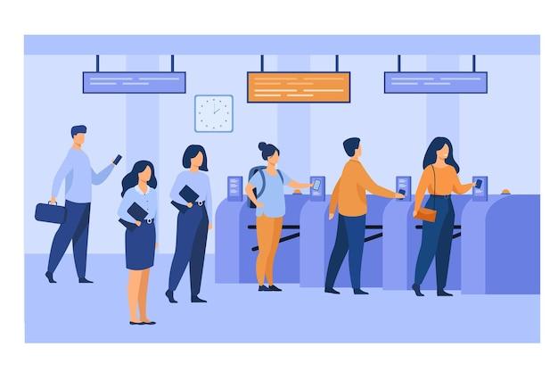 Pasajeros del metro escaneando boletos de tren electrónicos en la entrada y torniquetes. empleados del metro en uniformes manteniendo el orden