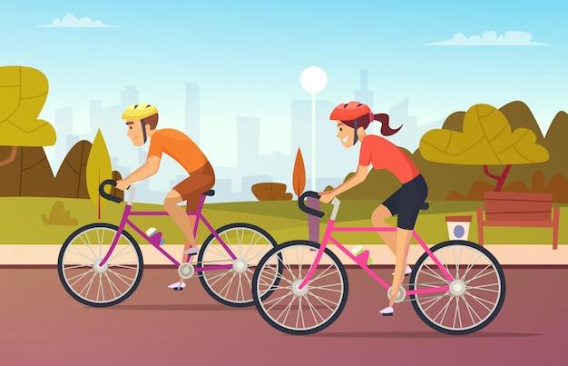 Paseos ciclistas masculinos y femeninos en el parque urbano.