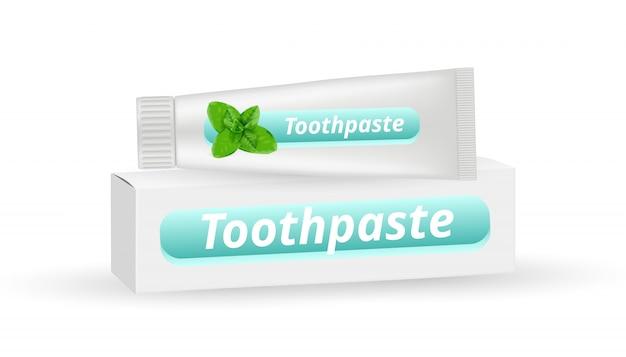 Pasta de dientes de menta. envase de caja blanca realista y tubo de pasta de dientes aislado sobre fondo blanco.