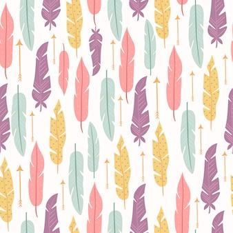 Pastel de patrones sin fisuras con plumas