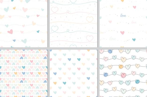 Pastel de san valentín doodle colección de patrones sin fisuras de corazón
