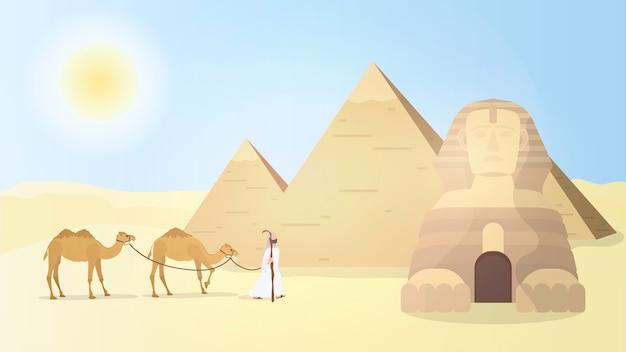 Un pastor conduce camellos por el desierto. pirámides egipcias, esfinge.