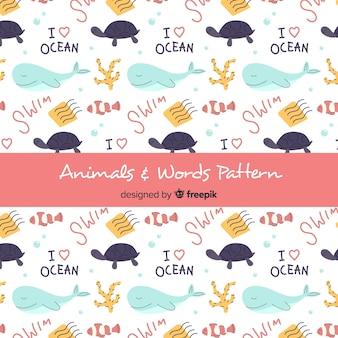 Patrón animales marinos y palabras dibujados a mano
