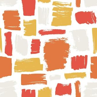 Patrón artístico sin fisuras con trazos de pincel rojo, naranja, amarillo sobre fondo blanco