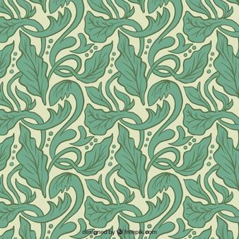 Patrón artístico con hojas dibujas a mano en estilo art nouveau
