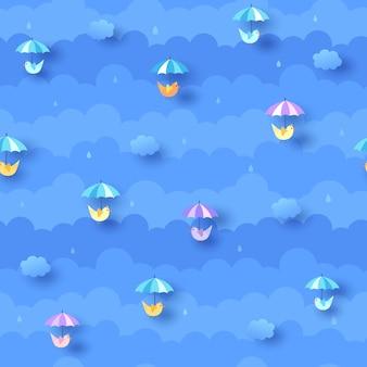 Patrón azul lluvioso con nubes y pájaros paraguas