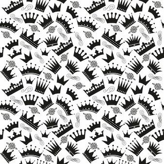Patrón blanco y negro con coronas