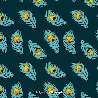 Patrón sin bordes de plumas de pavo real