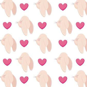 Patrón de cabezas de conejos con corazones.