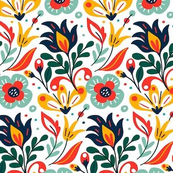 Patrón de coloridas hojas y flores exóticas