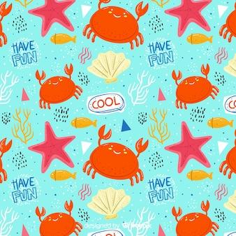Patrón colorido de garabatos de animales marinos y palabras