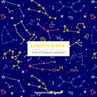 Patrón colorido zodíaco dibujado a mano