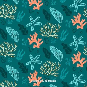 Patrón coral y conchas dibujado a mano