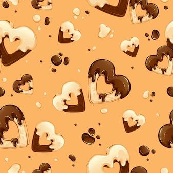 Patrón con corazones de galletas en glaseado de chocolate blanco y negro y con gotas de chocolate.