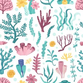 Patrón sin costuras con algas y corales.