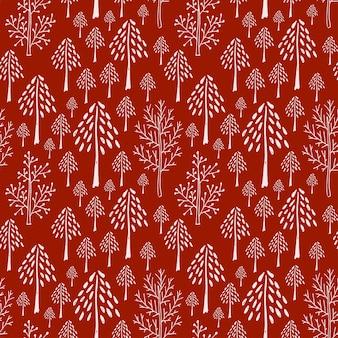 Patrón sin costuras de árboles en colores rojos