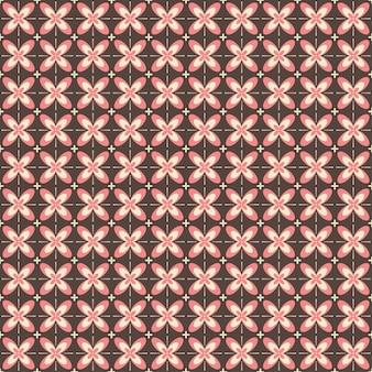 El patrón sin costuras de batik indonesio con varios motivos de la cultura tradicional javanesa, batik kawung en color rosa marrón, se puede aplicar a toda la tela