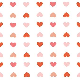 El patrón sin costuras de corazón rojo y corazón rosa