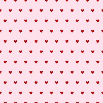 Patrón sin costuras de corazones sobre fondo rosa