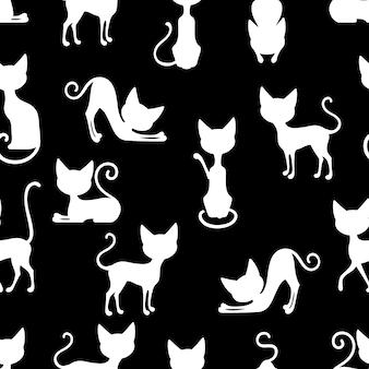 Patrón sin costuras de gatos blancos