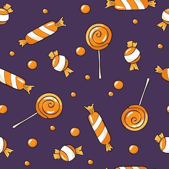 Patrón sin costuras de halloween con dulces