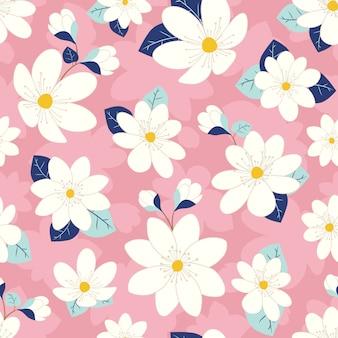 Patrón sin costuras lindas flores con fondo rosa