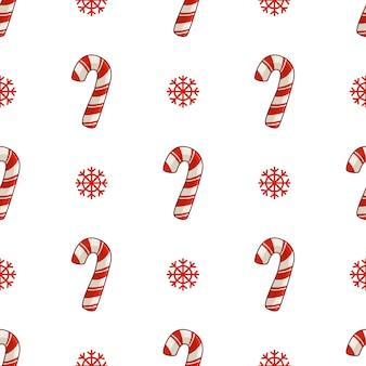 Patrón sin costuras de navidad con bastón de caramelo o dulce piruleta y copos de nieve