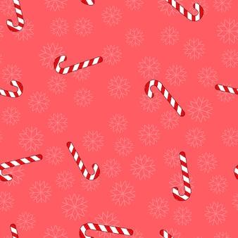 Patrón sin costuras de navidad con dulces y copos de nieve