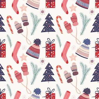 Patrón sin costuras de navidad con elementos lindos, ropa acogedora, dulces, ramas de pino y cajas de regalo, diseño de invierno de temporada