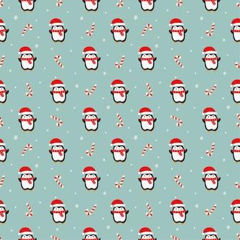 Patrón sin costuras de navidad con pingüino sobre fondo azul