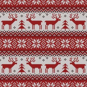 Patrón sin costuras de punto con ciervos y adornos escandinavos para el diseño de navidad.