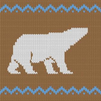 Patrón sin costuras de punto marrón con oso polar con nieve