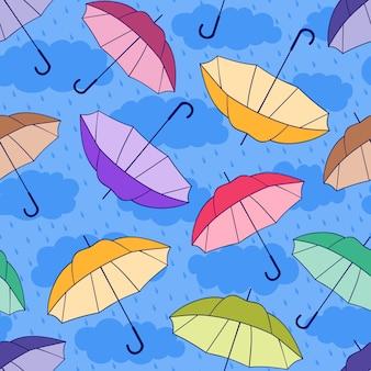 Patrón sin costuras con sombrillas de colores