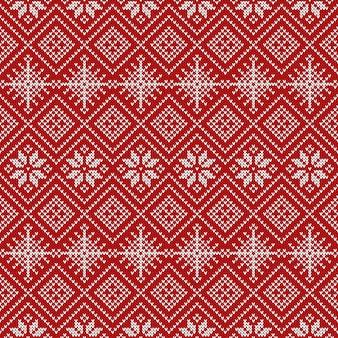 Patrón sin costuras tejido con copos de nieve y adornos tradicionales escandinavos.