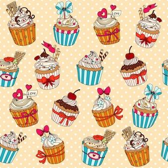 Patrón sin costuras vector con cupcakes