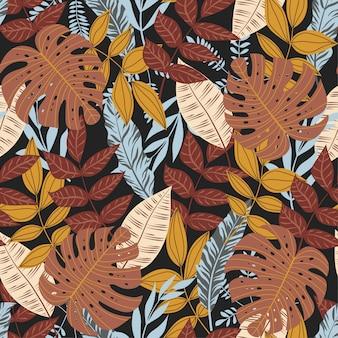 Patrón sin costuras de verano con coloridas plantas y hojas tropicales