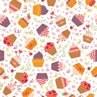 Patrón con cupcakes de dulces coloridos decorados con corazones, cerezas y estrellas