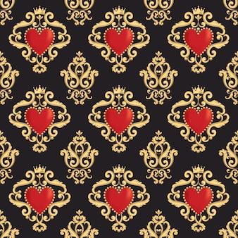 Patrón de damasco sin fisuras con hermoso corazón rojo ornamental con corona