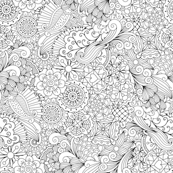 Patrón decorativo étnico de flores y remolinos.