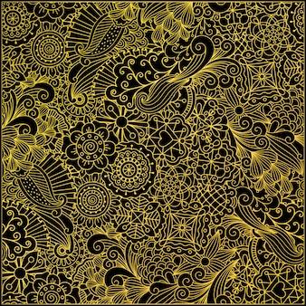 Patrón decorativo en hojas y remolinos dorados.