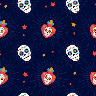 Patrón del día de los muertos con diseño plano de calavera