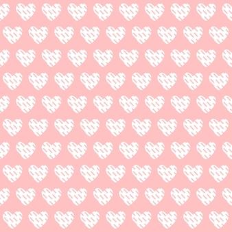 Patrón del día de san valentín sobre fondo rosa con corazones. diseño para papel de regalo, tela.