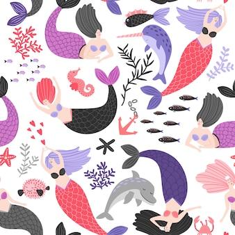 Patrón de dibujos animados sirenas y animales marinos